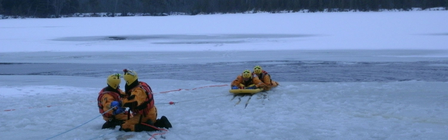 Firefighters practicing ice rescue