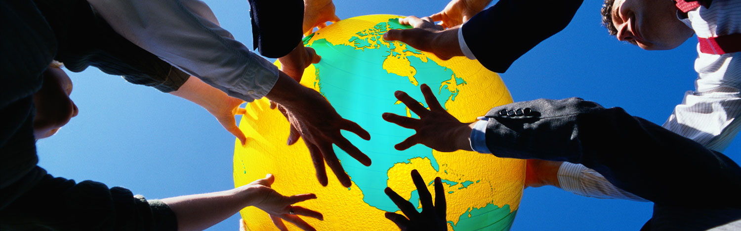 View of hands holding a globe up