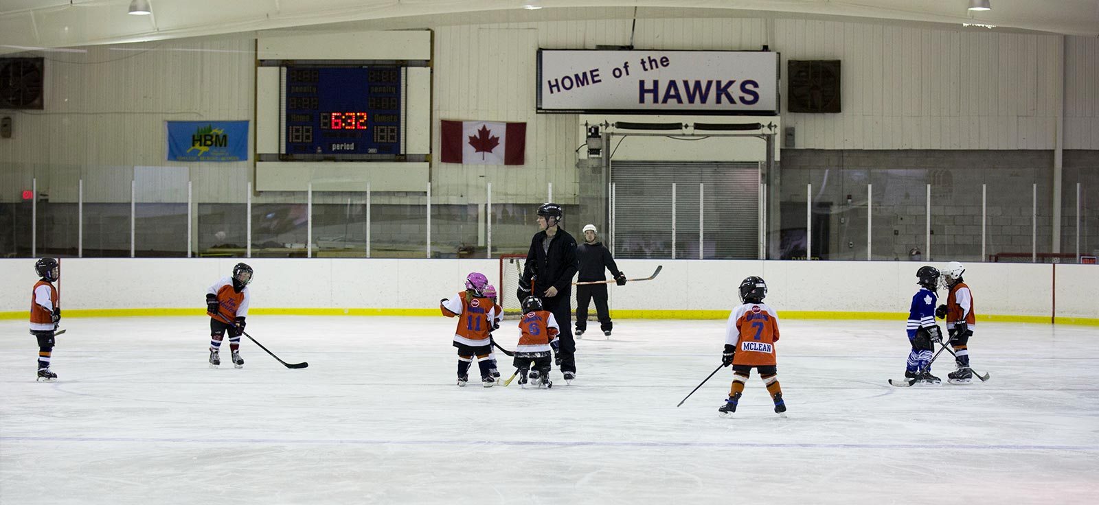 View of children practicing hockey at Arena
